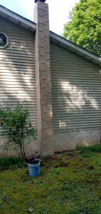 finished grey stucco on a narrow chimney