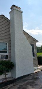 finished white stucco work on a large chimney
